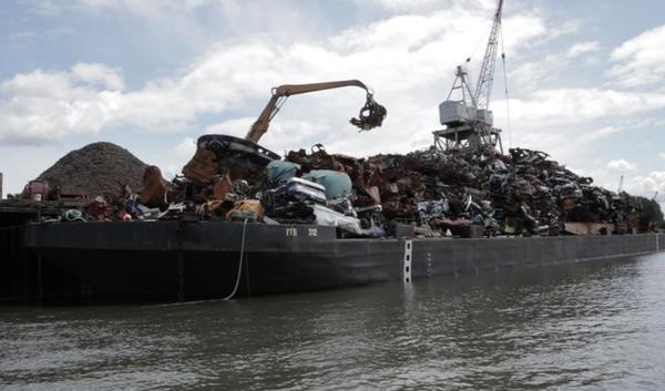 File photo of a metal recycling operation on the bank of the Duwamish River. A new cleanup plan announced Dec. 2, 2014 would spent $342 million from parties being held responsible for the river's pollution.