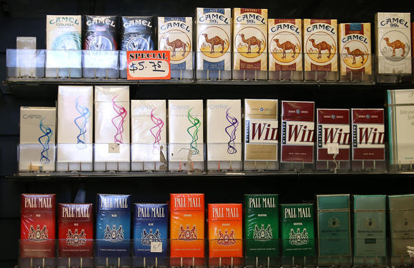 Cigarette brands manufactured by Reynolds Amercian are displayed at a tobacco shop on July 11, 2014 in San Francisco, California. (Justin Sullivan/Getty Images)