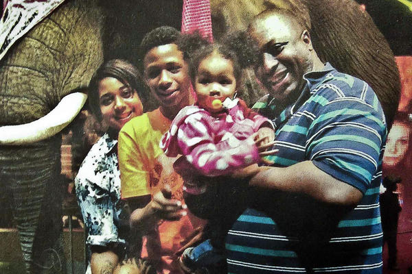"""Eric Garner (right) poses with his children in an undated family photo. Garner family attorney Jonathon Moore says he's """"astonished by the decision"""" not to have Pantaleo face charges, <a href=""""http://www.wnyc.org/story/stub-staten-island-grand-jury-decision-garner-case/"""">member station WNYC reports</a>."""