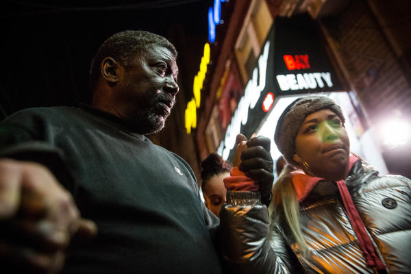 Benjamin Carr, stepfather of Eric Garner, who was killed by a police officer using a chokehold in July, prays with others Wednesday in Staten Island, N.Y. A grand jury declined to indict New York City Police Officer Daniel Pantaleo in Garner's death.