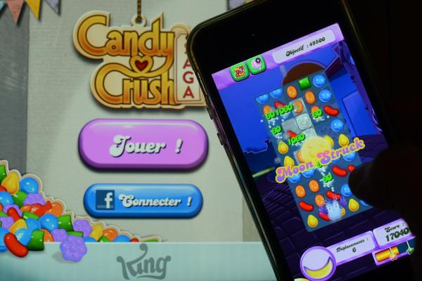 A man plays at Candy Crush Saga on his iPhone on January 25, 2014 in Rome. (Gabriel Bouys/AFP/Getty Images)