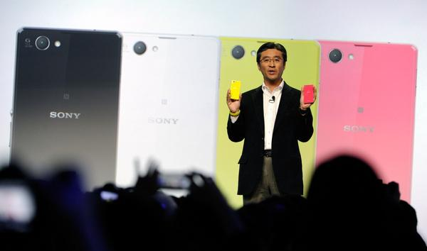 Sony Executive Vice President of Sony Corporation and Sony Mobile Communications President and CEO Kunimasa Suzuki displays a Sony Xperia Z compact phone during a Sony press event at the Las Vegas Convention Center for the 2014 International CES on January 6, 2014 in Las Vegas, Nevada. (David Becker/Getty Images)
