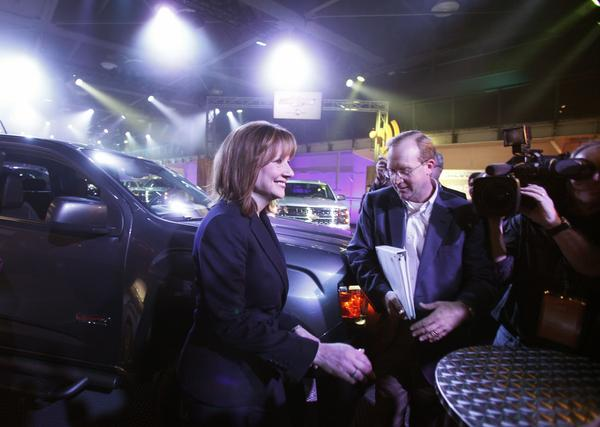 Mary Barra, the new CEO of General Motors, walks to a media scrum on the eve of the 2014 North American International Auto Show on January 12, 2014 in Detroit, Michigan. (Bill Pugliano/Getty Images)