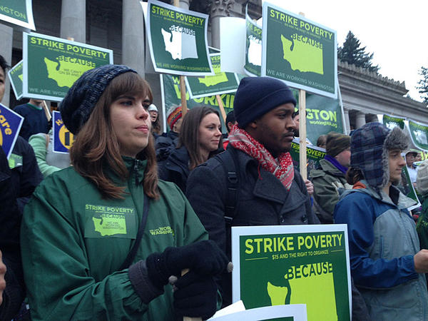 Activists rally in support of a $15 per hour minimum wage on the steps of the Washington capitol building in Olympia.