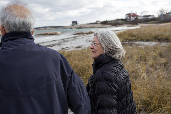 Bob and Pat Smithson walk to the beach on Cohasset Harbor near their home in Cohasset, Mass.