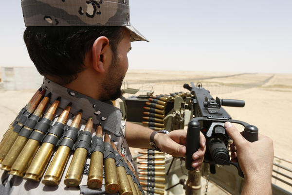A member of the Saudi border guards mans a machine gun at the border with Iraq in July. Since the so-called Islamic State launched its offensive this summer in Iraq, Saudi Arabia has sent thousands of troops to the region.