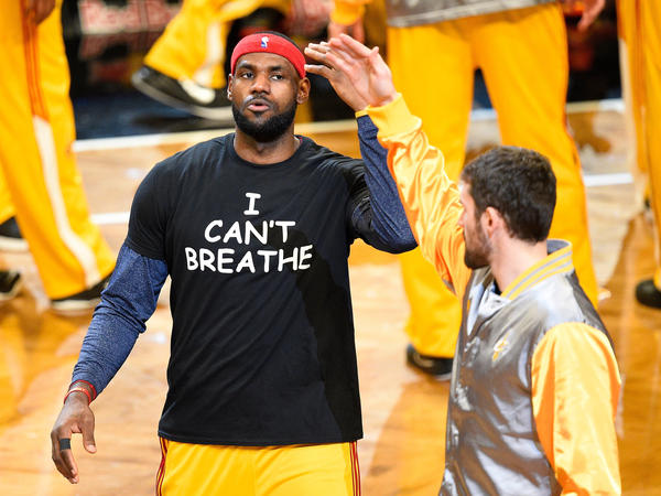 "Before Monday's game, Cleveland Cavaliers forward LeBron James protested the death of New Yorker Eric Garner by wearing an ""I Can't Breathe"" T-shirt."