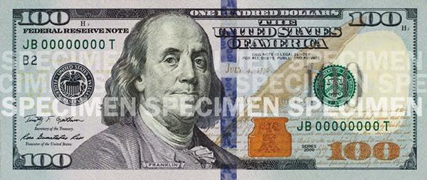 The new $100 bill has additional security features, and goes into circulation today. (newmoney.gov)