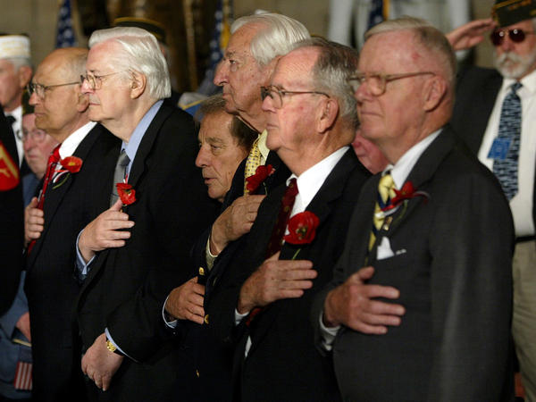 Rep. John Dingell (from left), D-Mich., Rep. Henry Hyde, R-Ill., Rep. Ralph Regula, R- Ohio, Rep. Ralph Hall, D-Texas, Rep. Cass Ballenger, R-N.C., and Rep. Amo Houghton, R-N.Y., stand at a House ceremony honoring World War II veterans in 2004.