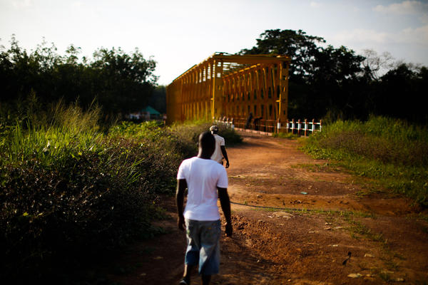 The bright yellow steel bridge over St. John's River is an official border crossing between Liberia and Guinea. The Liberian-Guinean border has been closed since July to help curb the spread of Ebola.