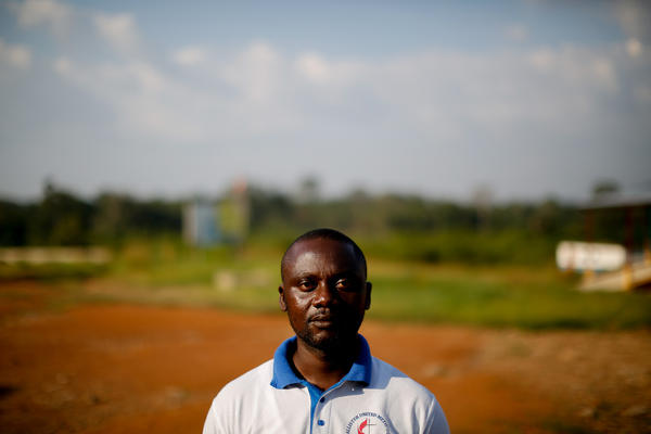 """Prince Dolo, 34, used to work as a money-changer at the border. Now there's no work. """"The reason why I'm not happy is that I have nothing to do,"""" he says. """"No means to live. So I think [when] disease stops killing, hunger kills."""" Now that Ebola is """"subsiding,"""" he says, Liberian President Ellen Johnson-Sirleaf should reopen the border."""