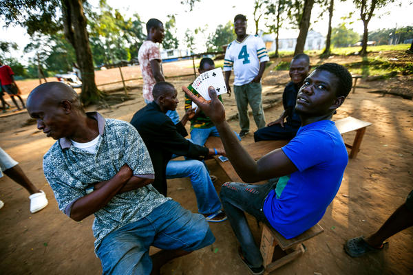 A group of now-unemployed men still gathers at the border each day to play cards and hang out.