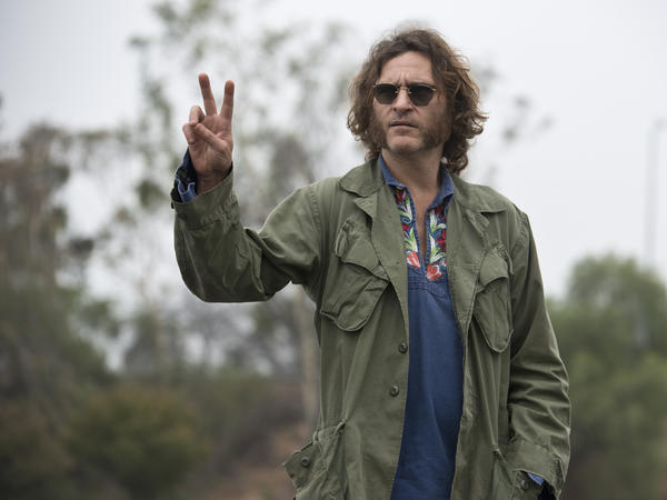 "Joaquin Phoenix stars as Larry ""Doc"" Sportello — a private investigator with a pot smoking habit — in <em>Inherent Vice</em>, Paul Thomas Anderson's film adaptation of the novel by Thomas Pynchon."