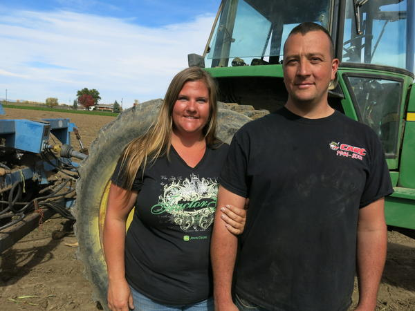 Sondra Pierce and her husband, Matt Pierce, stand in the middle of one of their sugar beet fields in rural Boulder County, Colo.