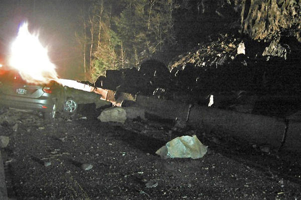 A landslide carried boulders onto I-84 near Hood River, Ore., on Wednesday.