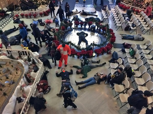Protesters hold a 'die-in' in the rotunda of the Oregon capitol building.