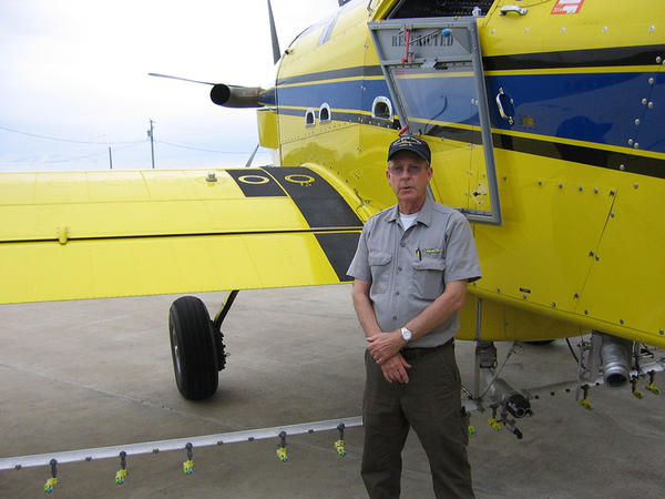 """Missouri pilot Mike Lee stands next to a crop-duster. """"I know some people who have had accidents. I've had friends that got killed in these things,"""" he says."""