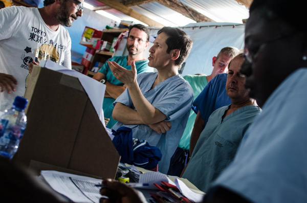 Dr. Thomas Frieden, director of the U.S. Centers for Disease Control and Prevention, talks with Doctors Without Borders staff during a visit in August to an Ebola treatment center in Monrovia, Liberia.