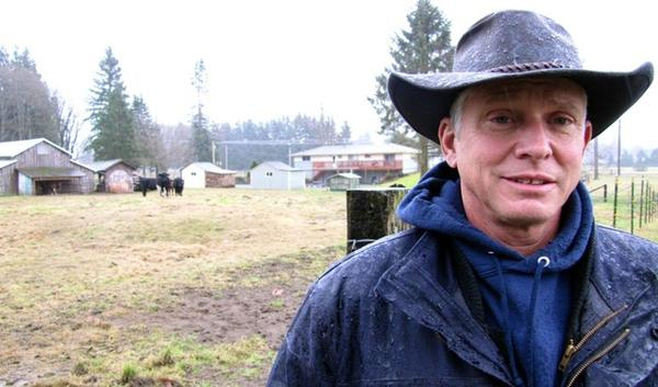 Richard Fox and his wife, Marnie, want to build a house and garage on their property near the Skagit River. The state says they can't have access to the water necessary to approve their building permit.
