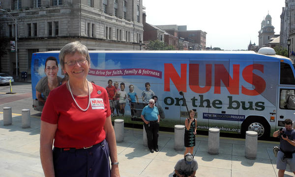 Sister Simone Campbell poses for a photograph in front of the 'Nuns on the Bus' bus after arriving at the state capitol in Harrisburg, Pennsylvania on June 28, 2012. The religious group, which is traveling by bus across the U.S., is protesting proposed federal budgets cuts that would affect poor families. (Brigitte Dusseau/AFP/Getty Images)