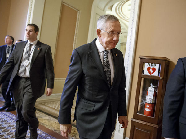 Senator Harry Reid of Nev. on Tuesday, walks to one of his final meetings as the Senate Majority Leader. In January, Republicans take over the majority.