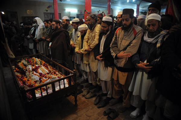 Pakistani mourners pray during the funeral of a student killed in the attack.
