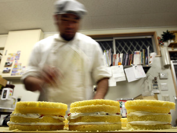 A man prepares a Christmas sponge cake at the Patisserie Akira Cake shop on Dec. 23, 2011, in Himeji, Japan.