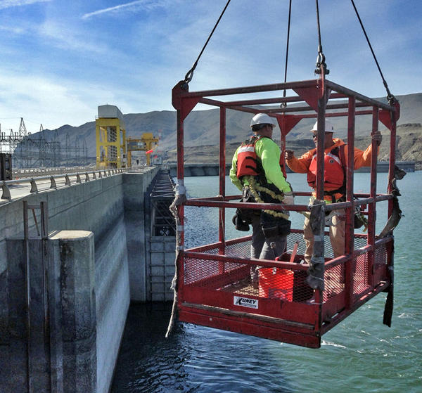 Workers scramble to place temporary fixes on the fish ladders at the cracked Wanapum Dam on the Columbia River.