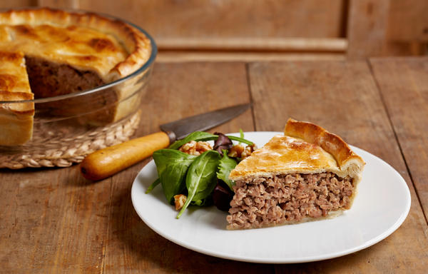 Tourtiere is a savory, spiced meat pie, which both French- and English-speaking Canadians love to serve around the holidays.