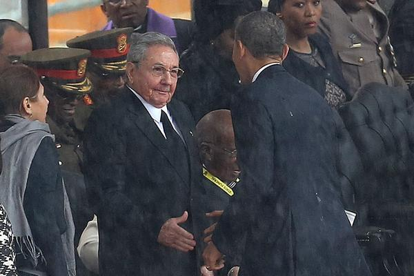 "Obama shakes hands with Castro during a memorial service for former South African President Nelson Mandela in Soweto, South Africa, on Dec. 10, 2013. Former Cuban leader Fidel Castro says his brother introduced himself to Obama in English, telling him, ""Mr. President, I'm Castro,"" as the two leaders shook hands."