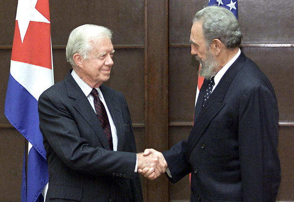 Former U.S. President Jimmy Carter (left) shakes hands with Cuban President Fidel Castro on May 12,, 2002, at the State Council in Havana, where Castro, Carter and their respective delegations met for a working meeting. Carter was on a five-day visit to Cuba, invited by Castro. (Adalberto Roque/AFP/Getty Images)