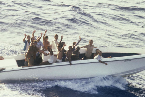 Refugees aboard a vessel in the small port of Mariel, Cuba, on April 23, 1980, wait to sail to the U.S. Fidel Castro agreed to let them leave the island for Florida in what became known as the Mariel boatlift. More than 100,000 Cubans made it to the U.S. The new arrivals included many thousands released from Cuba's prisons and mental institutions, leading to a tightening of the U.S. embargo.