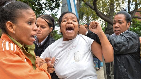 A member of the activist group Women in White is arrested during a demonstration to commemorate Human Rights Day in downtown Havana, on Dec. 10. Members of the opposition movement say they feel betrayed by the U.S. decision to restore ties with Cuba's communist regime.