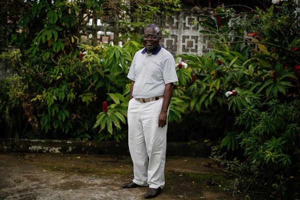 Dr. Senga Omeonga pictured outside St. Joseph's Catholic Hospital in Monrovia. Omeonga moved to Liberia from DRC in 2011. He contracted Ebola but survived it.