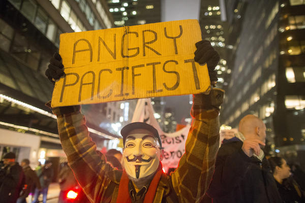 Protesters march through Midtown Manhattan on Tuesday, a day after New York City's mayor called for a pause in the demonstrations.