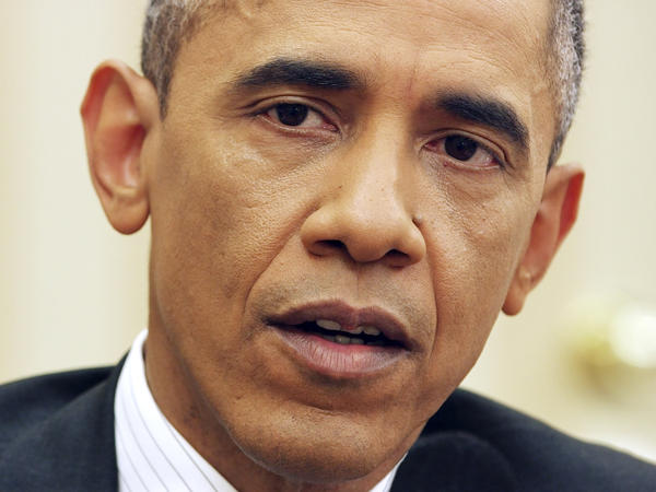 President Obama responds to a question from NPR's Steve Inskeep on Dec. 17 in the Oval Office.