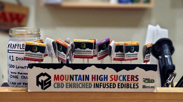 Marijuana-infused lollipops are displayed at a dispensary in Denver in 2013. Aspen, Colo., recently launched a marijuana education campaign to teach visitors how to use the drug safely.