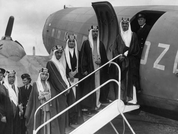 Five of Saudi King Abdul Aziz ibn Saud's sons board a plane at Herne Airport in Hampshire in August 1945. They are (from right) Amir Faisal (later King Faisal), Amir Mohammed, Amir Fahd (later King Fahd), Amir Abdullah al-Faisal (later King Abdullah) and Amir Nawaf. On the left is the Saudi ambassador in London.