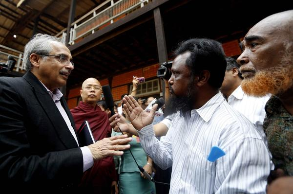 Vijay Nambiar (left), special adviser to the United Nations secretary-general, talks with a Muslim man at a temporary camp for displaced people in Meiktila in March. Muslims account for about one-third of the town's 10,000 residents; many are now homeless.