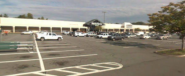A college student spent the night in jail and was charged with felony counts after agents approached her car, suspecting she bought beer at this Harris Teeter grocery store in Charlottesville, Va.
