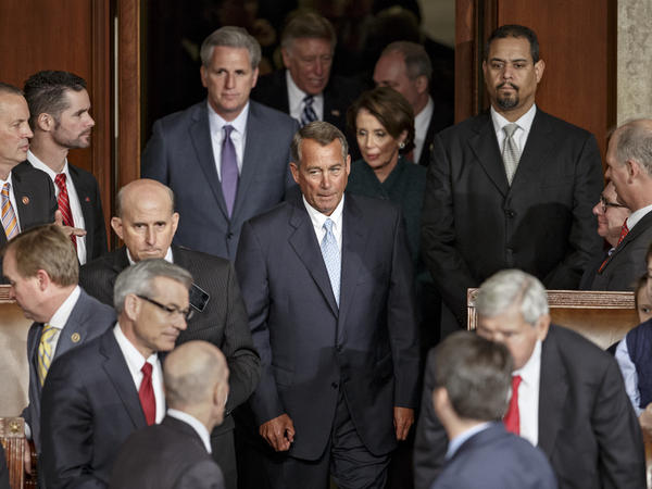 House Speaker John Boehner of Ohio arrives on the House floor in the Capitol on Tuesday, the opening session of the 114th Congress.