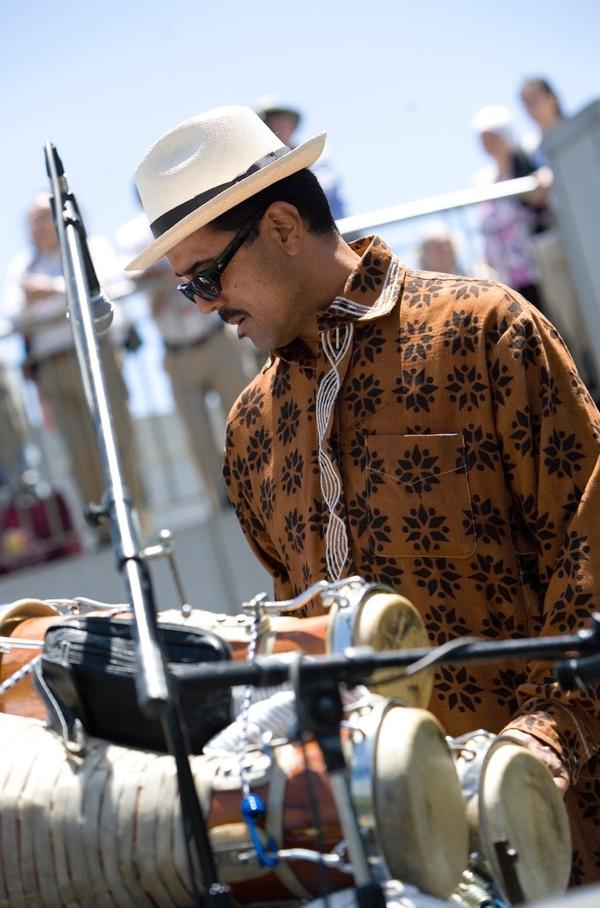 Percussionist and bandleader John Santos performs with Afro Cuban <em>batá</em> drums in California's Bay Area.