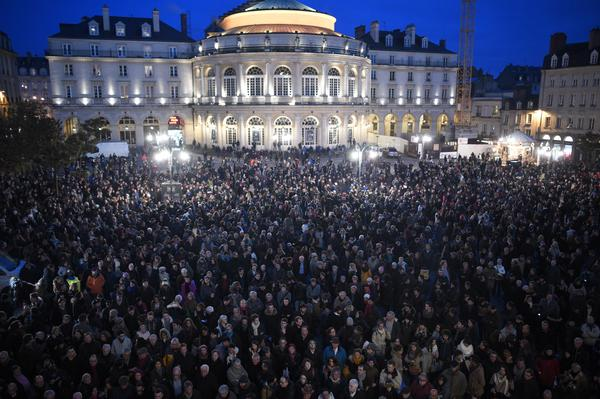 People gather in front of City Hall in Rennes, western France, in a show of respect for victims<em>.</em>