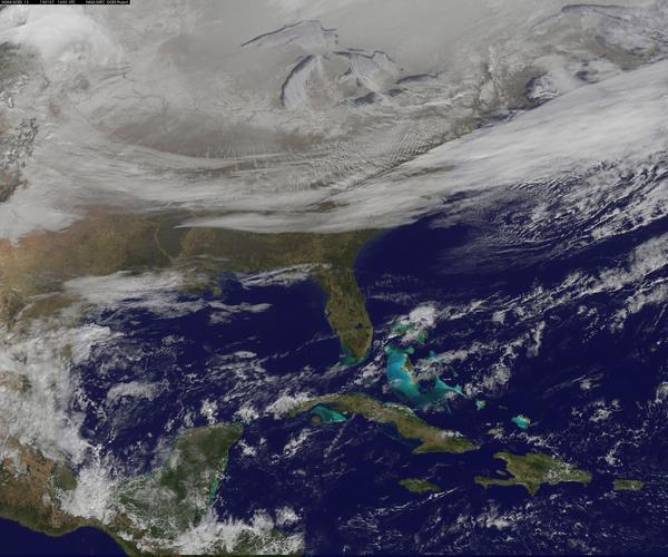 NOAA's GOES-East satellite provided a look at the frigid eastern two-thirds of the U.S. on Wednesday that shows a blanket of northern snow, lake-effect snow from the Great Lakes and clouds behind the Arctic cold front.