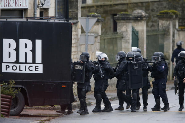 Authorities conduct a house-to-house search in Longpont, northeast of Paris. French anti-terrorism police converged on the area after the two suspects were spotted at a gas station in nearby Villers-Cotterets.