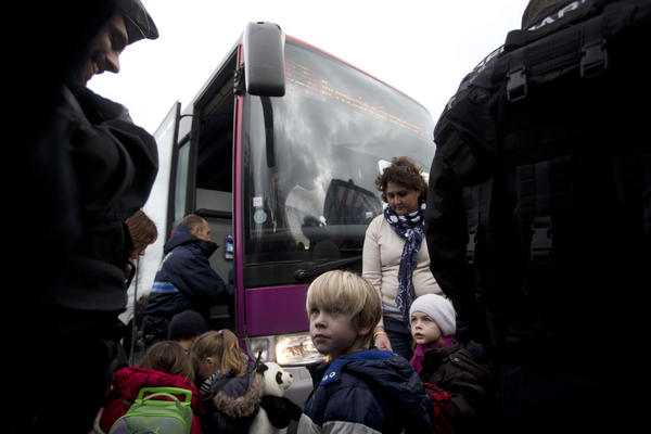 French military officials escort children from their school to a safe location to be picked up by their parents in Dammartin-en-Goele.