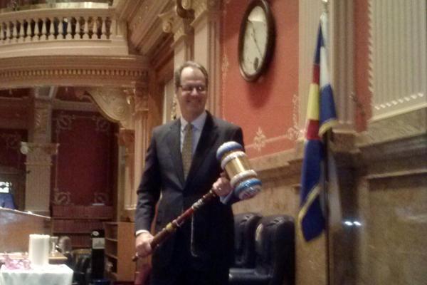 Senate President Bill Cadman (R-Colorado Springs) is holding outgoing speaker of the house Mark Ferrandino's (D-Denver) bedazzled gavel. Former Senate President Morgan Carroll (D-Aurora) gave it to Cadman as a joke.