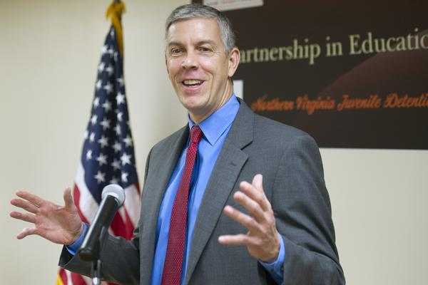 Education Secretary Arne Duncan speaks with reporters after he and Attorney General Eric Holder toured the Northern Virginia Juvenile Detention Center on Dec. 8, 2014.