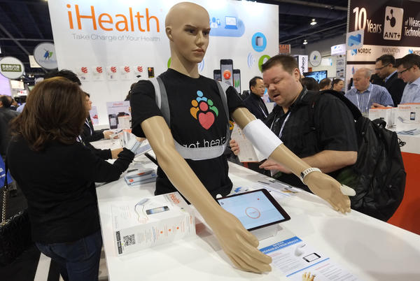 Visitors check out wireless blood pressure monitors at the Consumer Electronics Show in Los Angeles.