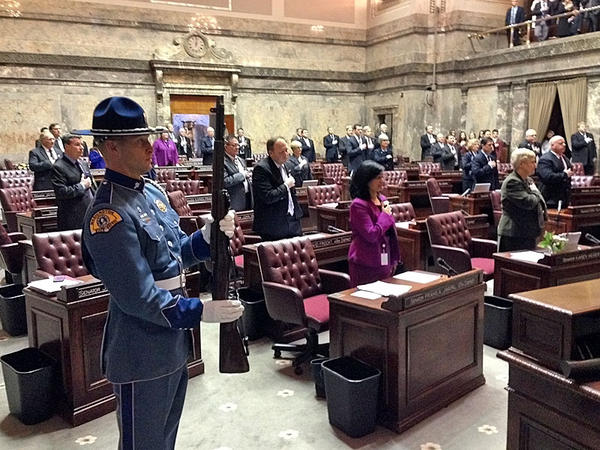 The formal ceremony ushering in the new session of the Washington legislature quickly gave way to partisan fireworks.